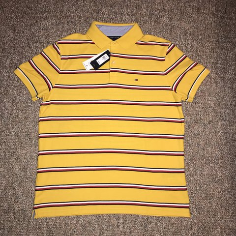 90da3d58 @miguel42. last month. Houston, United States. Brand new Tommy Hilfiger  polo with tags. Yellow with navy blue ...