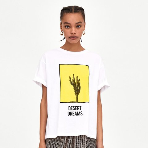 00c763c5 'Desert Dreams' white and yellow Graphic print t-shirt from - Depop