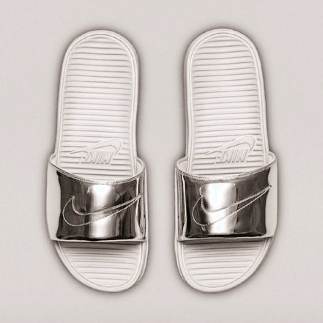 af3ebfaf4884 Silver Liquid Nike Benassi Slippers available now in size a - Depop