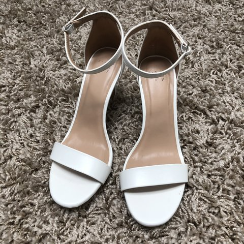 cbbb121cc10b   lgrat. 6 days ago. United States. White two strap sandals. Worn only once  for an all white party. Super comfortable heel