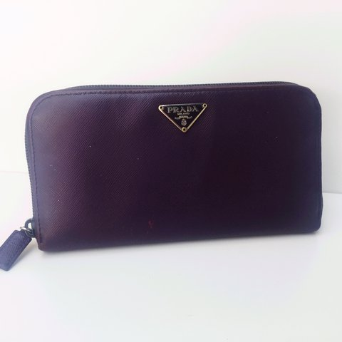 65c2d6befa48 @maison_anti. 2 years ago. London, United Kingdom. Purple Prada saffiano  wallet