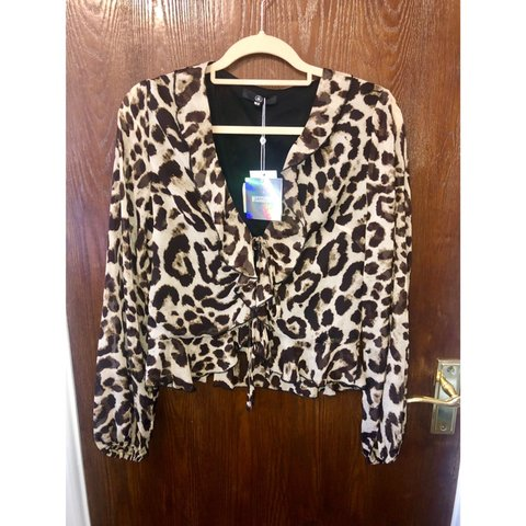 7fa25530c57a @hayleykelsey. last month. Colchester, United Kingdom. Leopard print shirt  with ruffles. Missguided ...