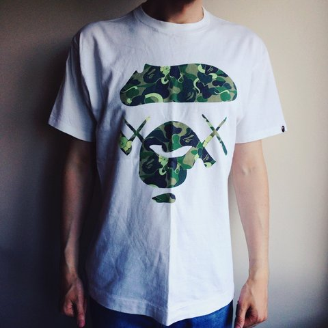 f6863f7c @adamberry1984. 4 years ago. London, UK. Bathing ape x Kaws green camo t- shirt #bathingape #bape ...