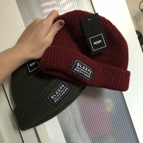 bed59be24aef4e While She Sleeps beanie hat in maroon and green / red khaki - Depop