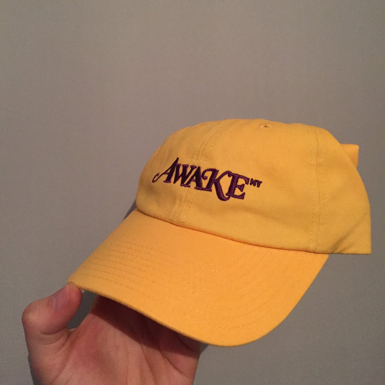 Awake NY Yellow Purple dad cap. Former Supreme Creative from - Depop 0130d7e834f