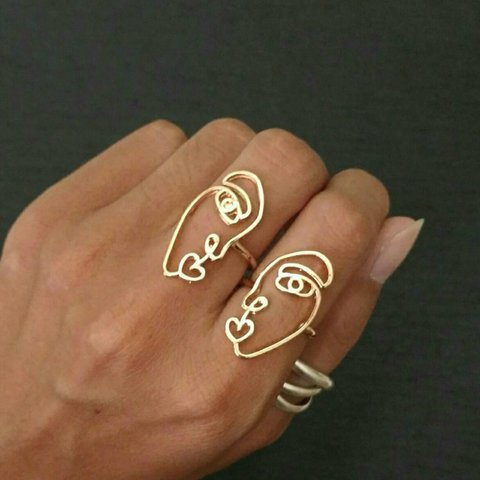 ff82ad0f3 @downabove. last year. United States. New ring set 2 rings. Abstract artsy  Picasso half face outline