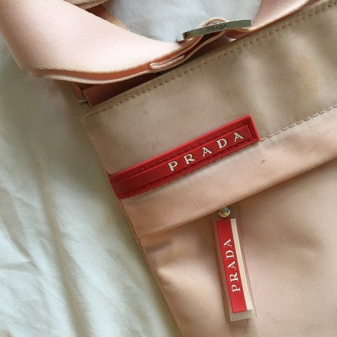 de5242c6fdf4 @_tarynrider. 7 months ago. United Kingdom. REDUCED PRICE - rare baby pink  Prada sport bag