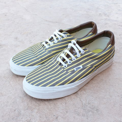 48605aa6a4 Vans grey and yellow striped low top skate shoe. Brown on of - Depop