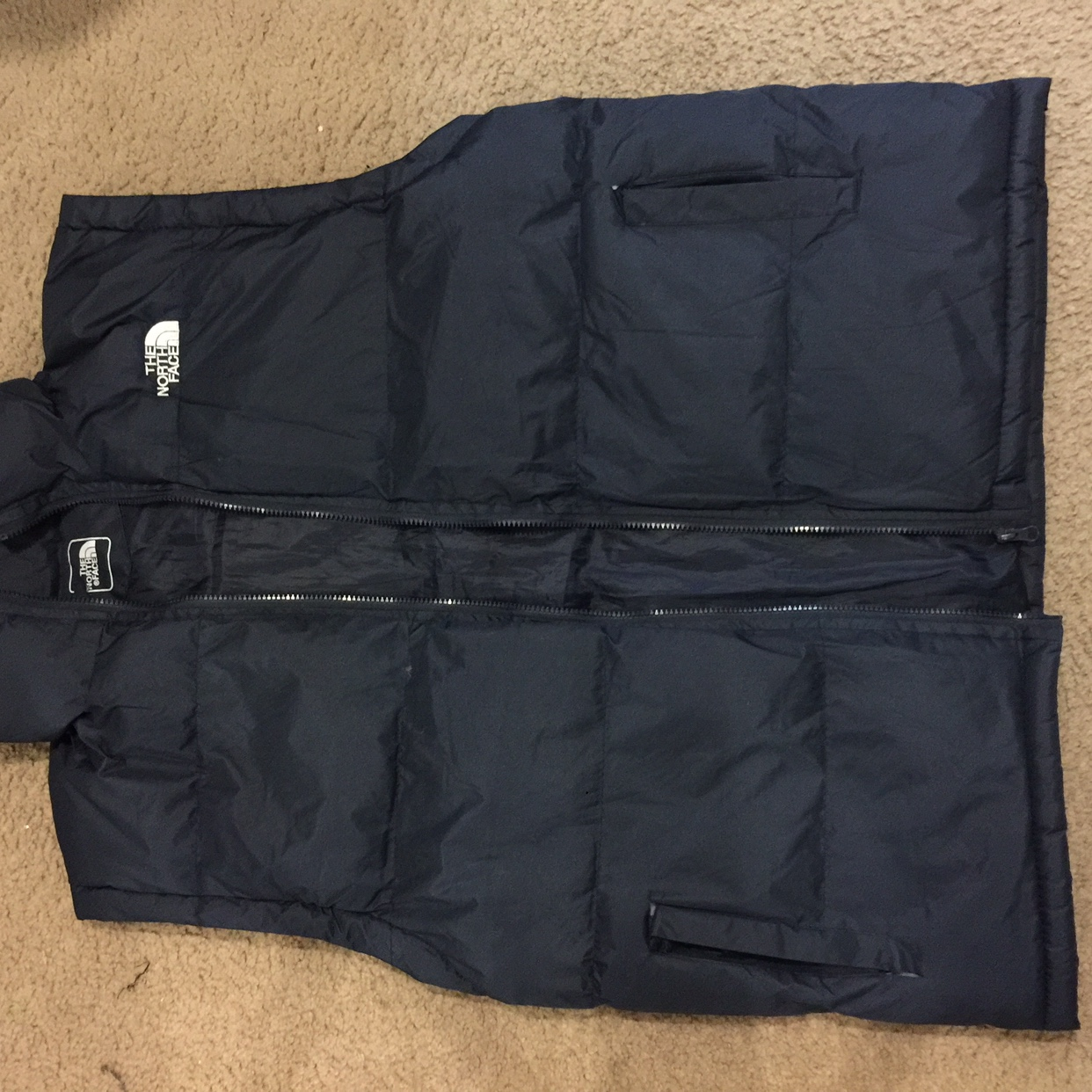 b92d58bef The North Face Bubble Vest. It's Navy Blue and fits... - Depop