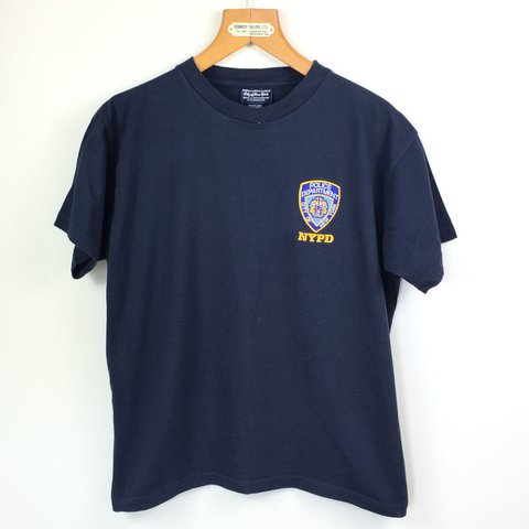 8ba87db77 @vintagesuzieq. 2 years ago. London, UK. OFFICIALLY LICENSED NYPD T SHIRT  SIZE MEDIUM ...