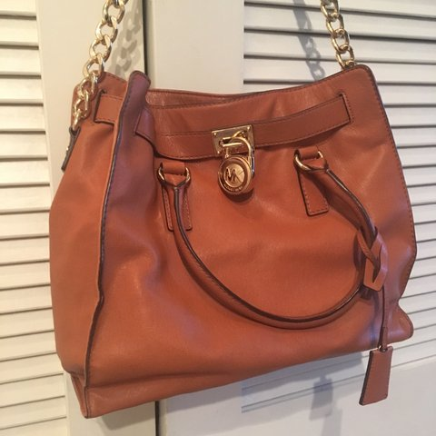 d8e7aaafb7d44e @thegothicsprite. last year. Austin, United States. Genuine leather camel  bag by Michael Kors. Accented with gold ...