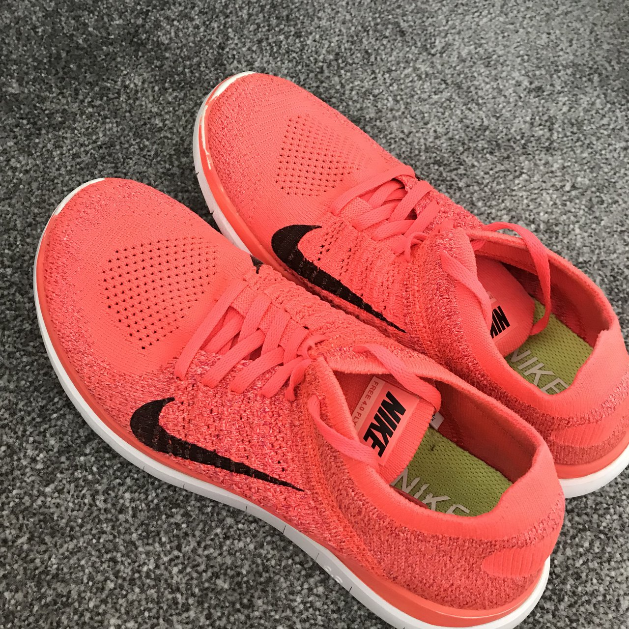 36936be70c0e Bright pink Nike Flyknit trainers