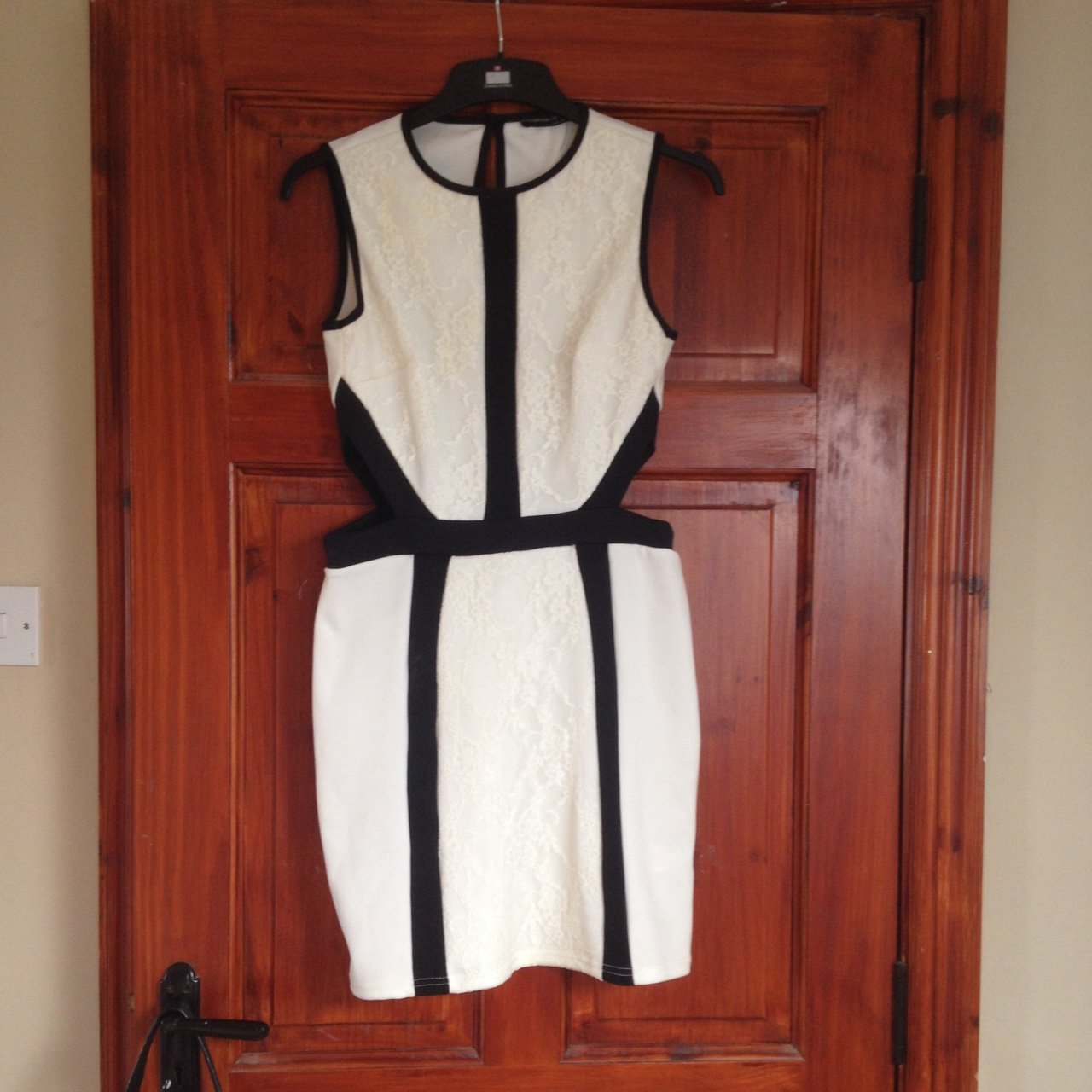 0ff0e93159a Black and white bodycon dress with cut out detail fits a 10 - Depop