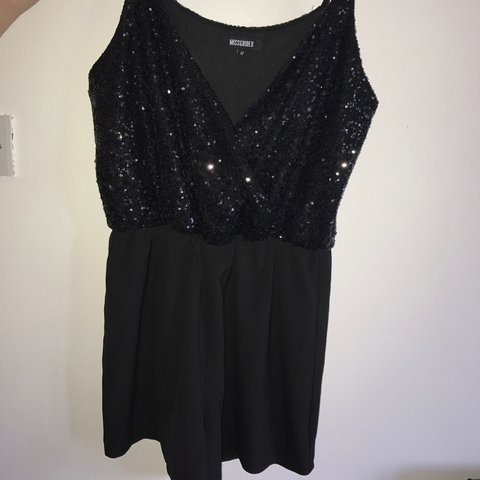 53f46f820e Sequin black wrap front playsuit Size 12 but it is a large a - Depop