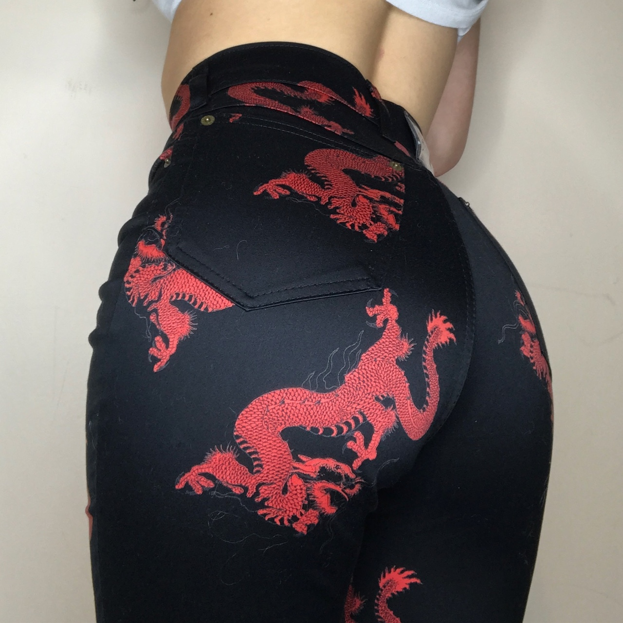 high waisted dragon pant by tark absolutely divine 1998 128009 high waisted dragon pant 128009 by tark 1 absolutely divine black soft stretch pant made of cotton polyester lycra covered in red detailed dragons
