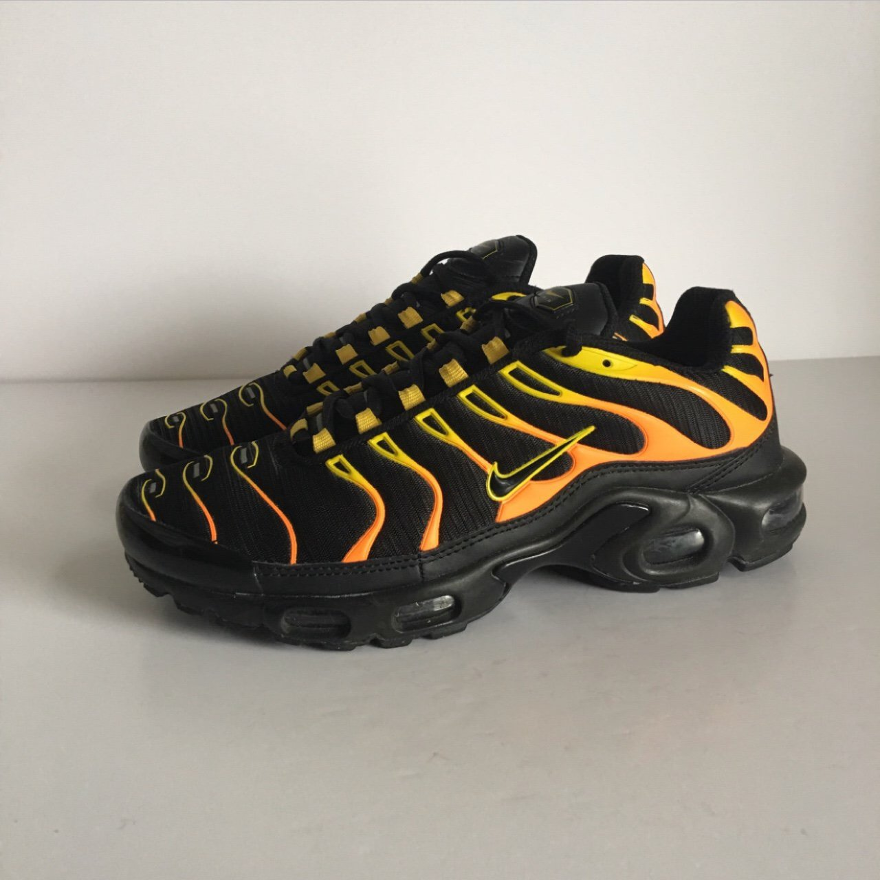 6ee30fffcb msg me offers Nike tns in black orange yellow colour way - 6 - Depop