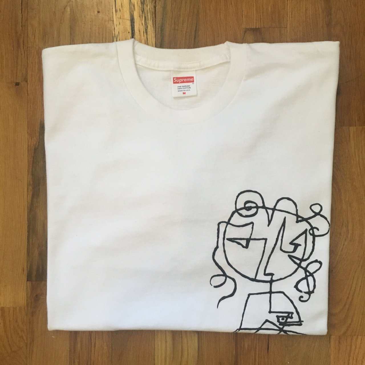 6709a708 Supreme long sleeve tee is size medium with doodle on the is - Depop