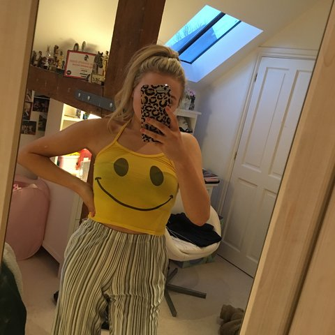 ac6c2e5e @emmacording. 2 months ago. East Grinstead, United Kingdom. yellow smiley  face halter crop top from omighty🐯✨ dollskill urban outfitters ...