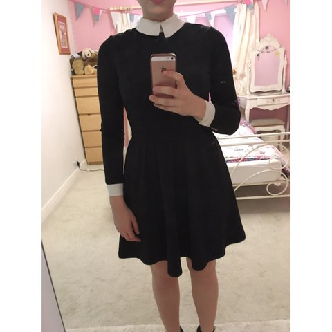 719c86c875 @jxmiehxrseman. last year. Stroud, UK. Long sleeve black dress with white  collar and cuffs with short, skater style skirt ...