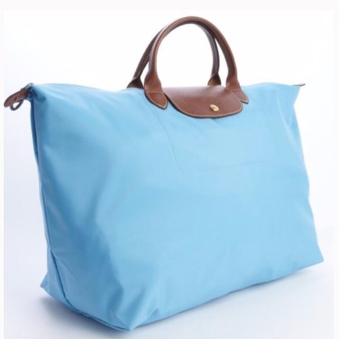 Longchamp Le Pliage Travel bag in light blue or a lovely and - Depop 5abd5a2df421a