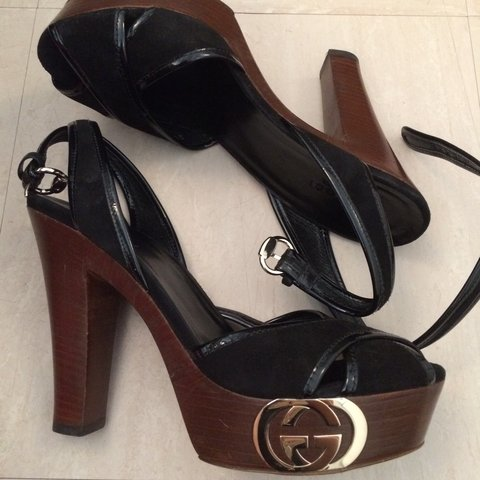 581f74f567f Women s black Gucci shoes wooden platform and heel with Worn - Depop