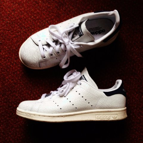 f7e575f9332e  tiphfrenchie. 4 years ago. Adidas originals white and navy Stan Smith  cracked leather trainers ...