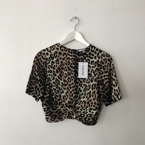 02bee87c @thefashionmedley. 10 months ago. Montréal, Canada. RESERVED Ganni Calla  leopard print silk cropped top with twisted front
