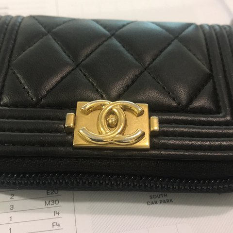 b39cb821e1f8 Preloved Chanel boy zippy card holder in black lambskin gold - Depop