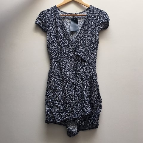 fb95c2d5b56b  suhleenaq. in 6 hours. United States. Brandy Melville blue and white  floral Hannah romper playsuit
