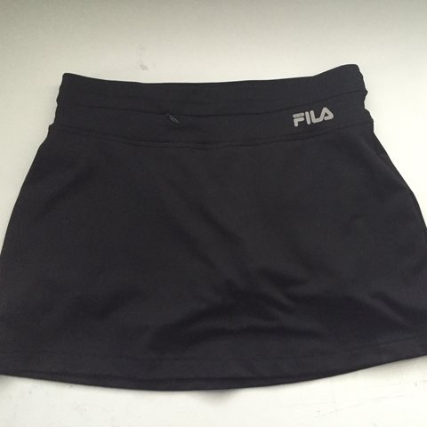 6dd7d1ee9d47 @chloewut. 3 years ago. Englewood, FL, USA. Black Fila athletic sport skirt  with built in spandex shorts.