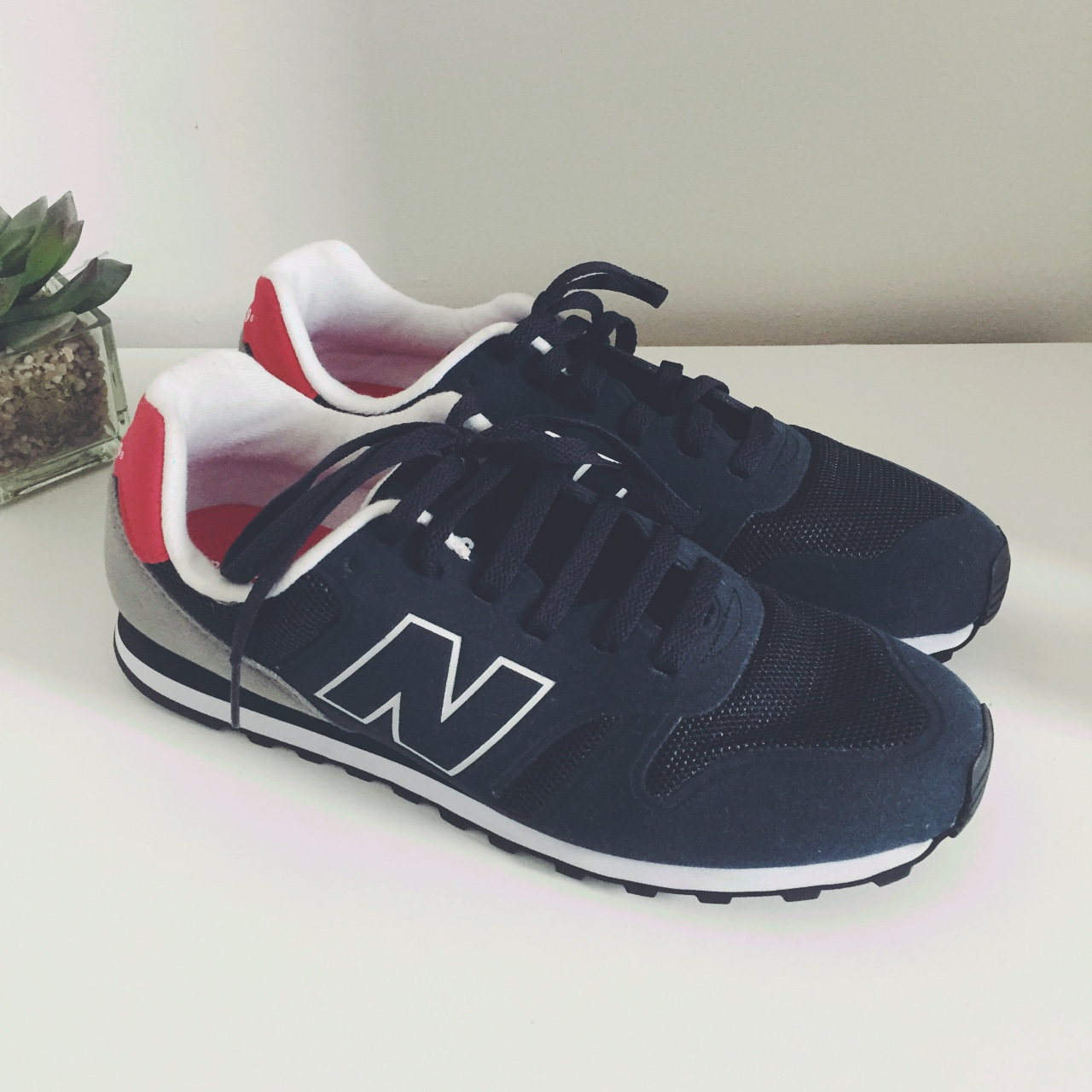 the latest c38a6 a8197 Men's UK 9/EU 43 New Balance 373 navy, red and grey ...