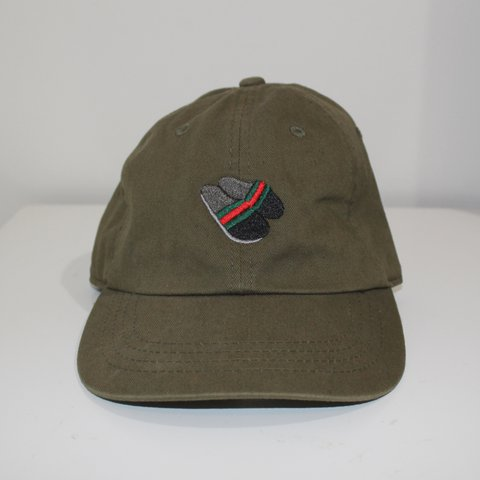 aa2b4294 in Gucci flip flops dad hat. Dark olive green, strap. - Depop