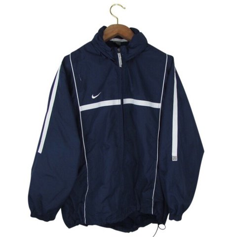 3df41b1a7 @pomgom. last year. London, United Kingdom. Nike Jacket in Navy Blue