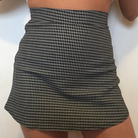 b38a1251aca2 @eviesandwell. last year. Esher, United Kingdom. Cute little black and white  checkered mini skirt from Brandy Melville.