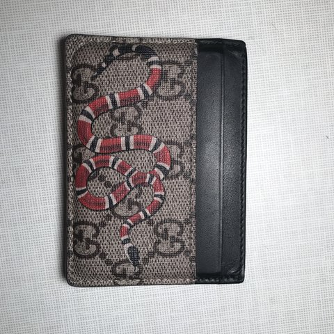 b48bc92e6551 @konnor. 9 months ago. Atlanta, United States. Authentic Gucci snake card  holder. This thing has been used ...