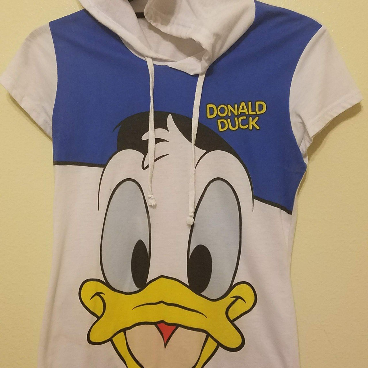 29071f58151c Hooded Donald Duck face shirt. Second picture shows slight - Depop