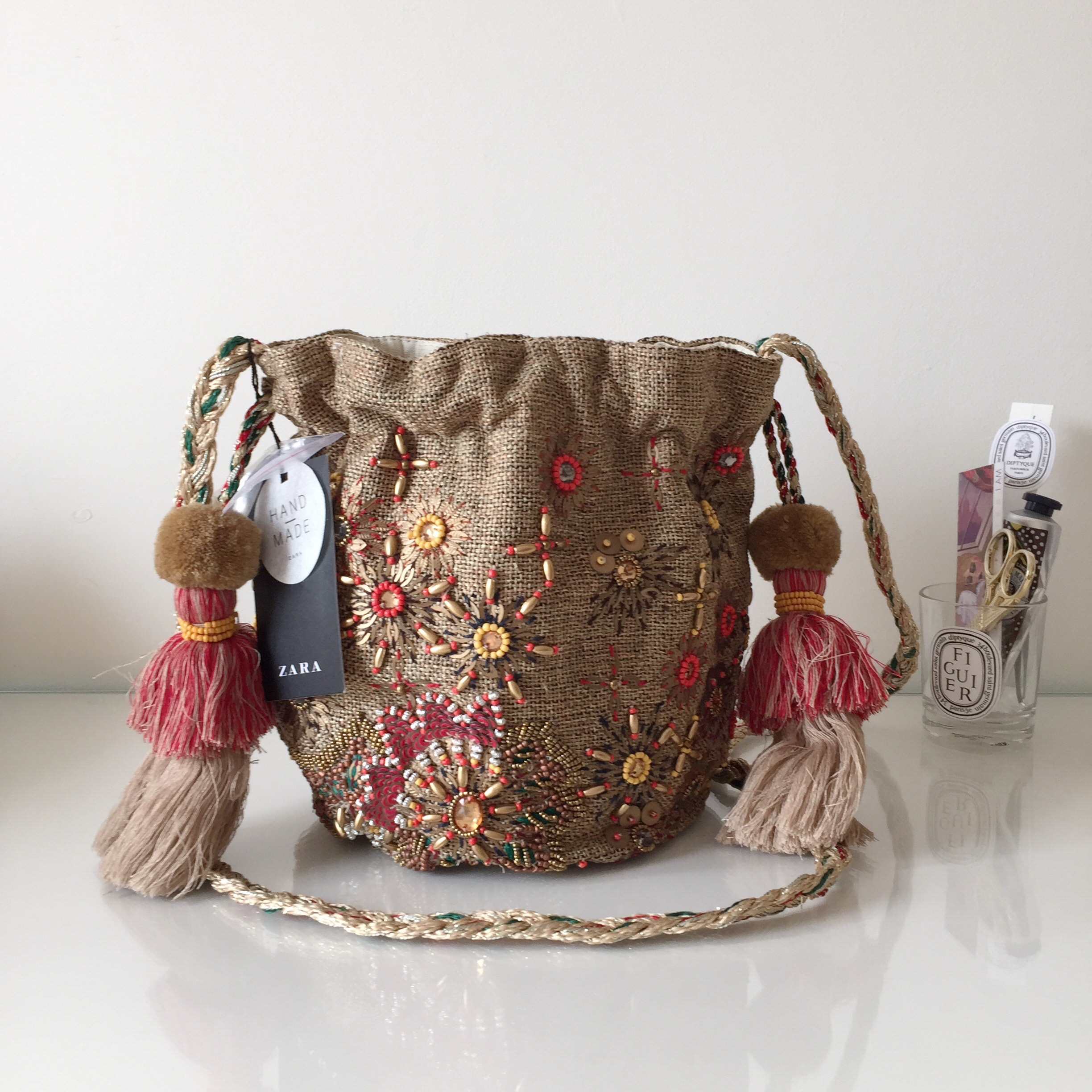 6fcdeca32f5 Zara beaded bucket bag with tassles and pom poms.... - Depop