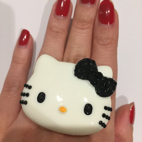 60d17fdee @cuties4us. 8 months ago. Los Angeles, United States. New handmade XL Hello  Kitty bling black bow ring. Adjustable ring band.
