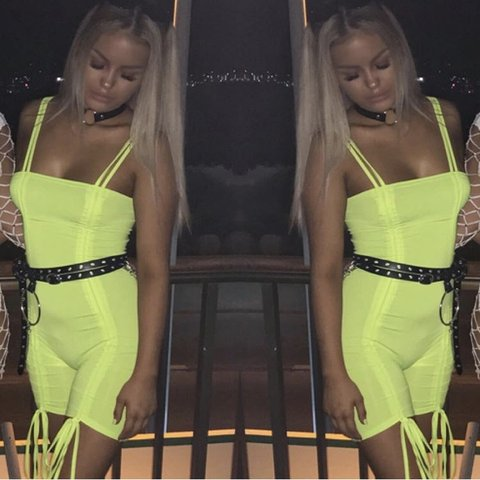 a1f7a2460c9 She has evolved neon green playsuit Selling for £22 postage - Depop