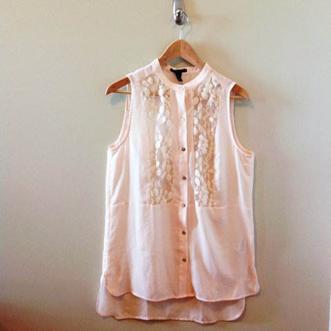 fc28ac1d @funnylilasiangal. 2 years ago. Illinois, USA. Forever21 light peach  sleeveless button down shirt.