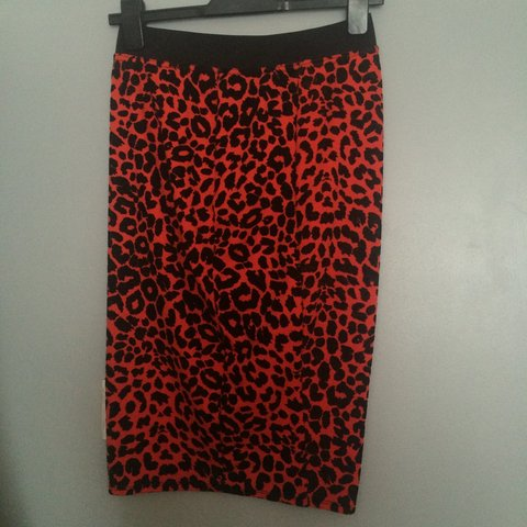 d0478be25b @ahooton. 4 years ago. Bootle, Merseyside, UK. Red and black leopard print  midi skirt ...