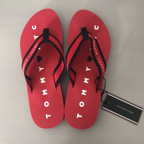 ee29adf51 Tommy Hilfiger navy and red padded flip flops with woven 7. - Depop
