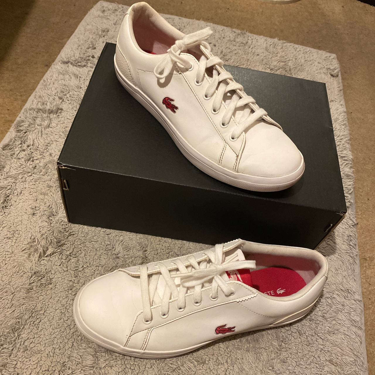 White lacoste trainers with pink detail