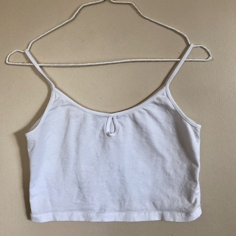 5e13fe5a479 @clairmadux. 3 months ago. Garden Grove, United States. Brandy Melville  white tank top. Worn once.