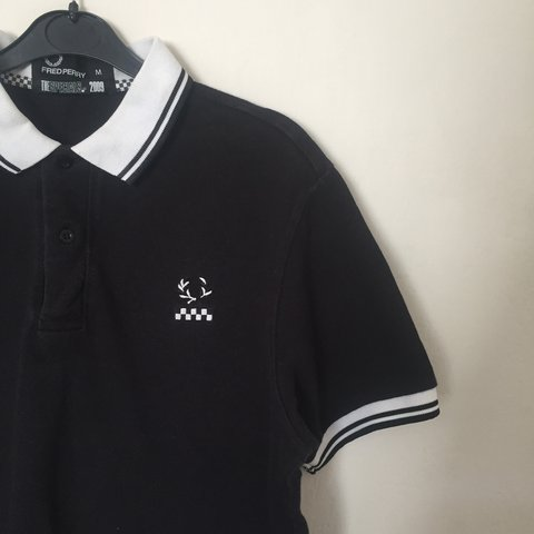 b155b7b2 @bombuce. 2 years ago. Stoke-on-Trent, United Kingdom. Men's MEDIUM LIMITED  EDITION 'The specials 2009' black and white Fred Perry.