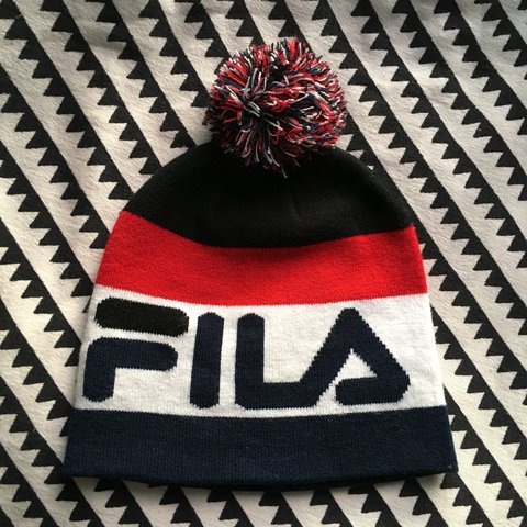 b7a2824e16 Knitted Fila Beanie Bobble hat    Only worn a couple times - Depop
