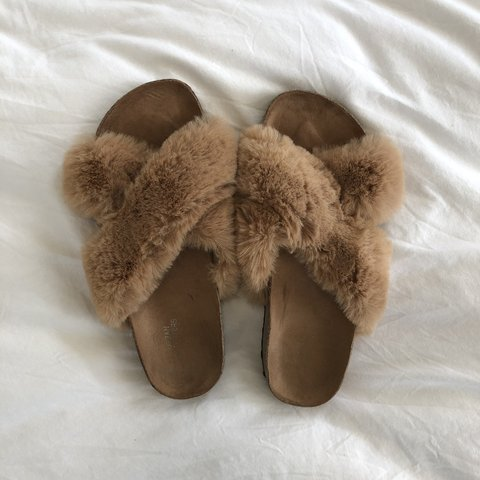 a5fcebec91b9 Birkenstock style fuzzy furry tan slides from Urban They are - Depop