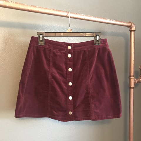 b1ef3d8d1c @clairescott. last year. Fayetteville, United States. maroon Brandy Melville  faux suede skirt with silver snap buttons