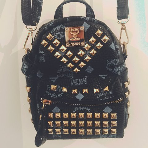 85511c3fa Small mcm backpack bag with stud detail and long strap, in - - Depop
