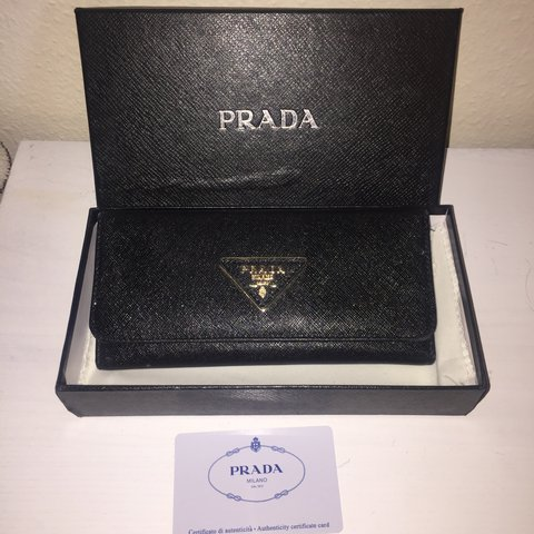 cfd4b529c79ed6 @megdaniells. last year. Manchester, United Kingdom. Black leather Prada  ladies wallet. Comes with box, dust bag and authenticity card.